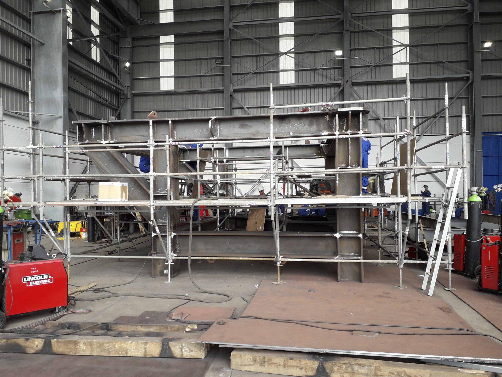 Mude fabrication process certifies welding procedures